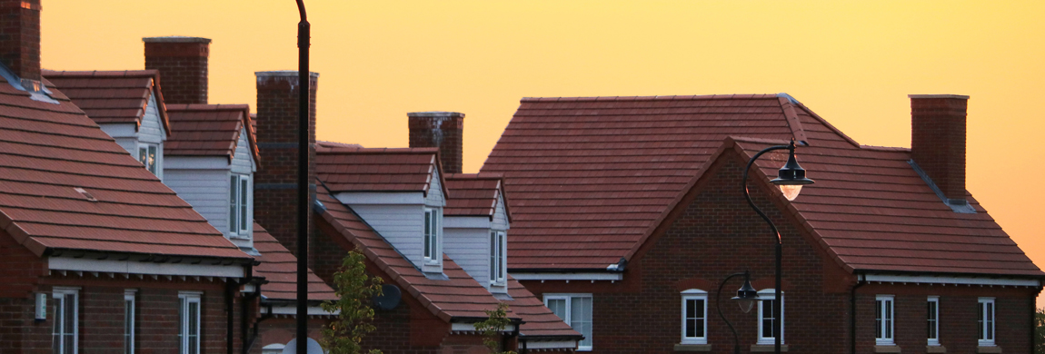 row of houses at sunset